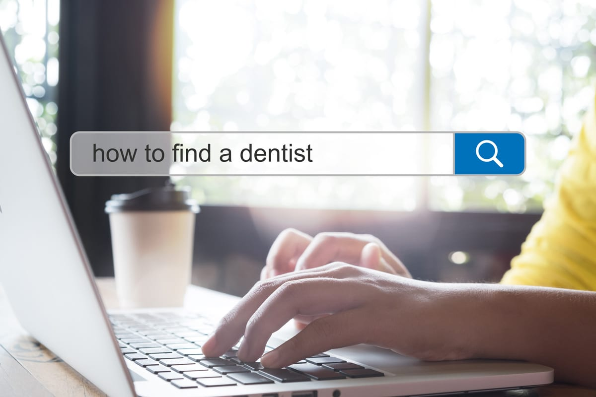 "person searching for ""how to find a dentist"" on their computer 