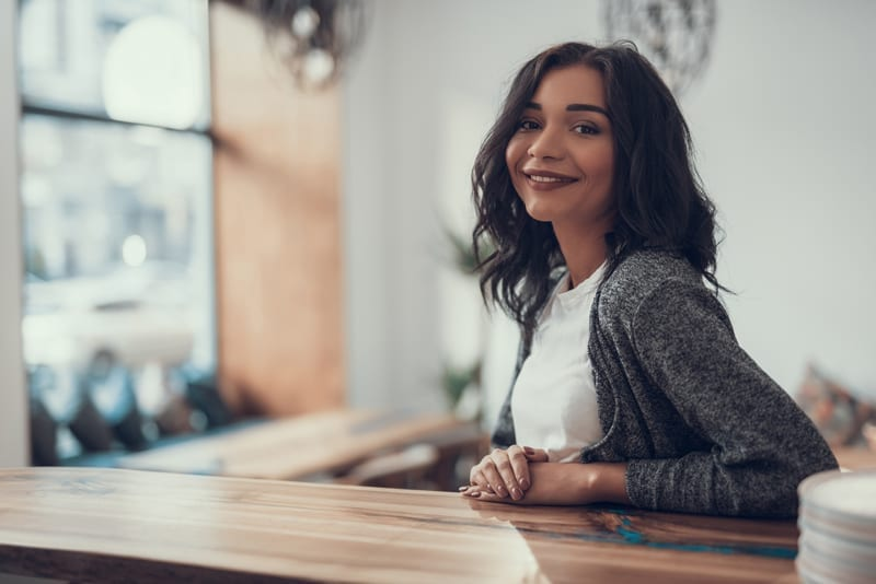 Relaxed Woman sitting at counter at West Richland Family Dental